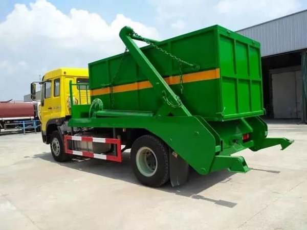 HOWO 4x2 swing arm garbage truck with 10M3 skid loader contatiner